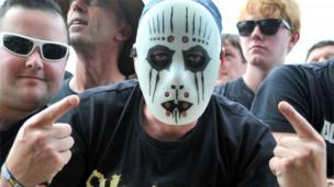 A Slipknot fan poses for a photo before the 3 Doors Down performance at Download festival on Friday