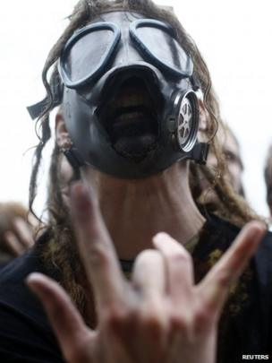 A fan listens to Papa Roach during the Download festival on Friday