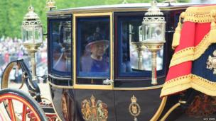 The Queen sits in her carriage looking out at crowds along The Mall. Photo: Jack Jones