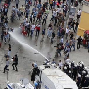 Riot police use water cannon to disperse anti-government protesters at Taksim square in central Istanbul