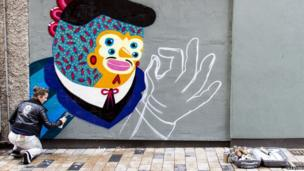 Artist KASHINK painting her street art