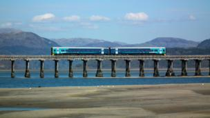 A train crossing the Mawddach estuary