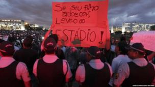 Demonstrators display a banner during a protest against the Confederations Cup in Brasilia, 17 June 2013