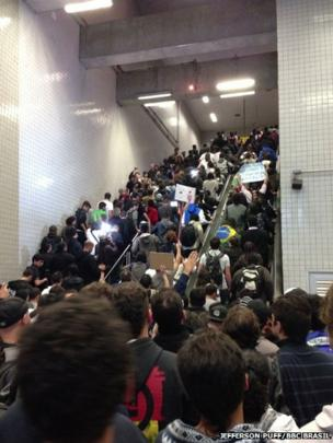 People exiting Sao Paulo's Faria Lima subway station on 17 June 2013