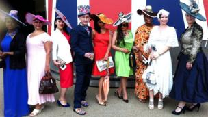 Andrew Fisher at Royal Ascot with women modelling his hat designs