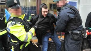 PSNI remove protester from street