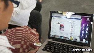 Man looks at Facebook