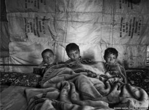 Syrian children inside their tent in Lebanon's Bekaa Valley.