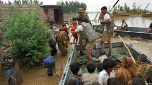 In this photograph received from the Defence Ministry on June 19, 2013 members of the Indian Defence Forces rescue stranded villagers in the northern Uttarakhand state