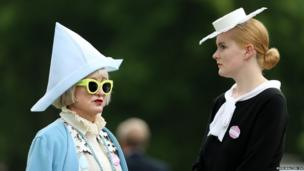 Race goers arrive on the third day of the Royal Ascot meeting in Berkshire