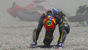 Luis Rossi of France gets up following a crash