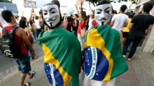 Demonstrators wearing Guy Fawkes masks in Recife city on 20 June 2013