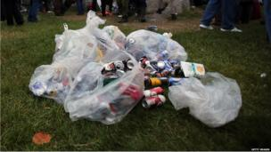 Empty cans of alcohol are collected in bags