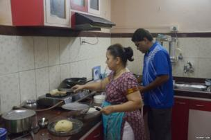 The Prabhoo family in their kitchen