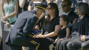 Brig Gen Richard Clarke, Commandant of Cadets at the US Military Academy at West Point, presents a flag to Elizabeth Harman, sister of Lt Col Jaimie Leonard (20 June 2013)