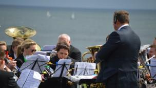 Brass band and conductor