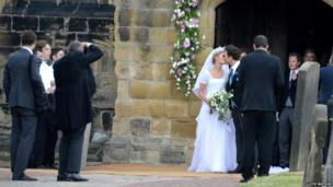 Photographer taking a picture of the couple