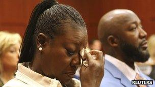 Trayvon Martin's parents listens to the description of their son's death during the opening day of the trial in Sanford, Florida, on 24 June 2013