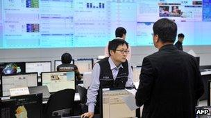 File photo: Members of the Korea Internet Security Agency check on cyber attacks at a briefing room of KISA in Seoul on 20 March 2013