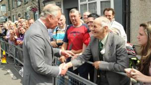 A firm handshake: Prince Charles greets local people in the village of Caledon, County Tyrone