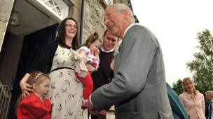 Prince Charles meets the Irvine family at Mill Street Cottages
