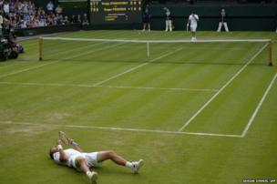 Sergiy Stakhovsky celebrates victory over Roger Federer at Wimbledon