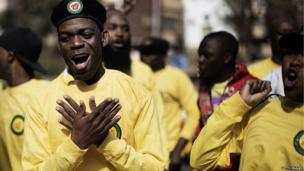 Members of the ruling African National Congress (ANC) party supporters dance outside the hospital (27 June 2013)