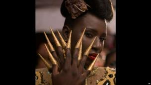 A model with gold fingers at a fashion show in Dakar, Senegal - Saturday 22 June 2013