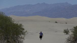 Man walks through Death Valley, California (28 June 2013)
