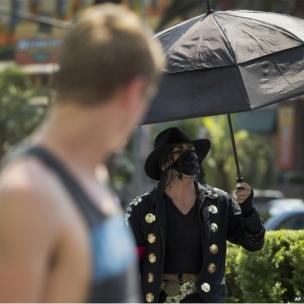Michael Jackson impersonator under an umbrella on The Strip, Las Vegas (28 June 2013)