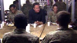 David Cameron eating with troops in Camp Bastion