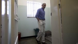 US President Barack Obama inside the cell on Robben Island where Nelson Mandela was held by South Africa's former apartheid government.
