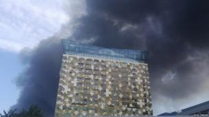 The Cube, Birmingham, surrounded by smoke. Photograph by Ellie Canham.