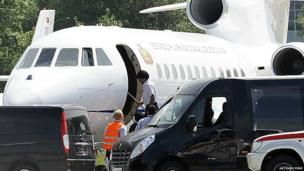 Evo Morales, centre, boards his plane at Vienna's Schwechat airport, Wednesday, 3 July