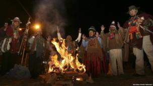 Aymara witch doctors give thanks for the arrival of Evo Morales outside of El Alto airport on the outskirts of La Paz, 3 July