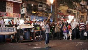 A young Egyptian boy holds fireworks during celebrations in Tahrir Square, the day after former Egyptian President Mohammed Morsi, was ousted from power