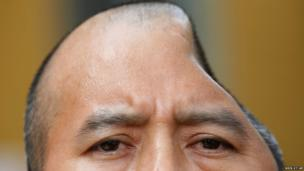 Antonio Lopez Chaj, a 43-year-old house painter, appears at a news conference in Los Angeles