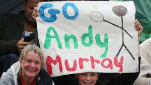 Girl holds sign supporting Murray.