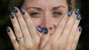 Woman with Andy Murray nail art.