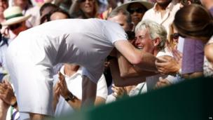 The Wimbledon champion climbed through the crowd to thank his team, including his mum Judy.