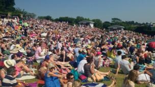 People relaxing at Wimbledon.