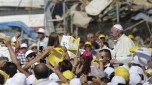 The Pope rides an open-topped car on Lampedusa