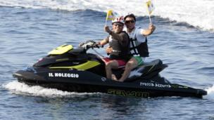 Jetski riders welcome the Pope to Lampedusa
