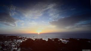 Sunrise over St John's Point, taken from Annalong by David McConnell, Kilkeel