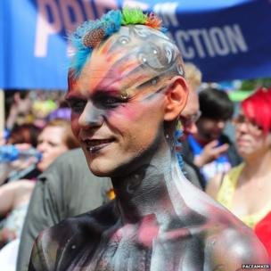 Gay pride man covered in head and body paint