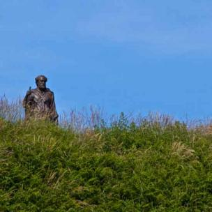 Alun Jones of Llanbadarn Fawr said he met this statue of St Caranog walking towards him through the grass as he walked the coastal path in Ceredigion