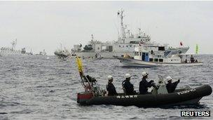 File photo: Japanese Coast Guard vessels, Japanese fishing boats, and a Chinese surveillance ship in the East China Sea near the disputed islands, known as Senkaku in Japan and Diaoyu in China, 26 May 2013