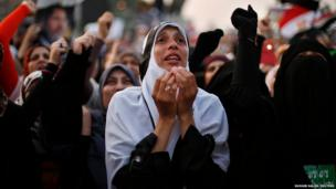 A supporter of deposed Egyptian President Mohammed Morsi attends a protest outside the Rabaa Adawiya mosque in Cairo