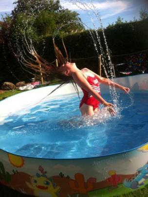 Zara in her paddling pool