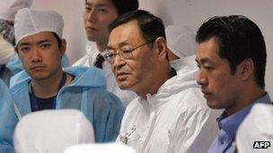 Masao Yoshida (C), former chief of Tokyo Electric Power Co Fukushima Dai-ichi nuclear power plant, seen in a file image from 12 November 2011